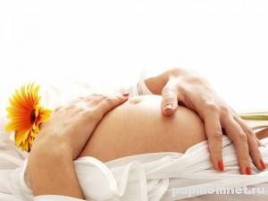 Фото беременной девушки к статье о появлениях папиллом при беременности