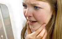 болит родинка на лице